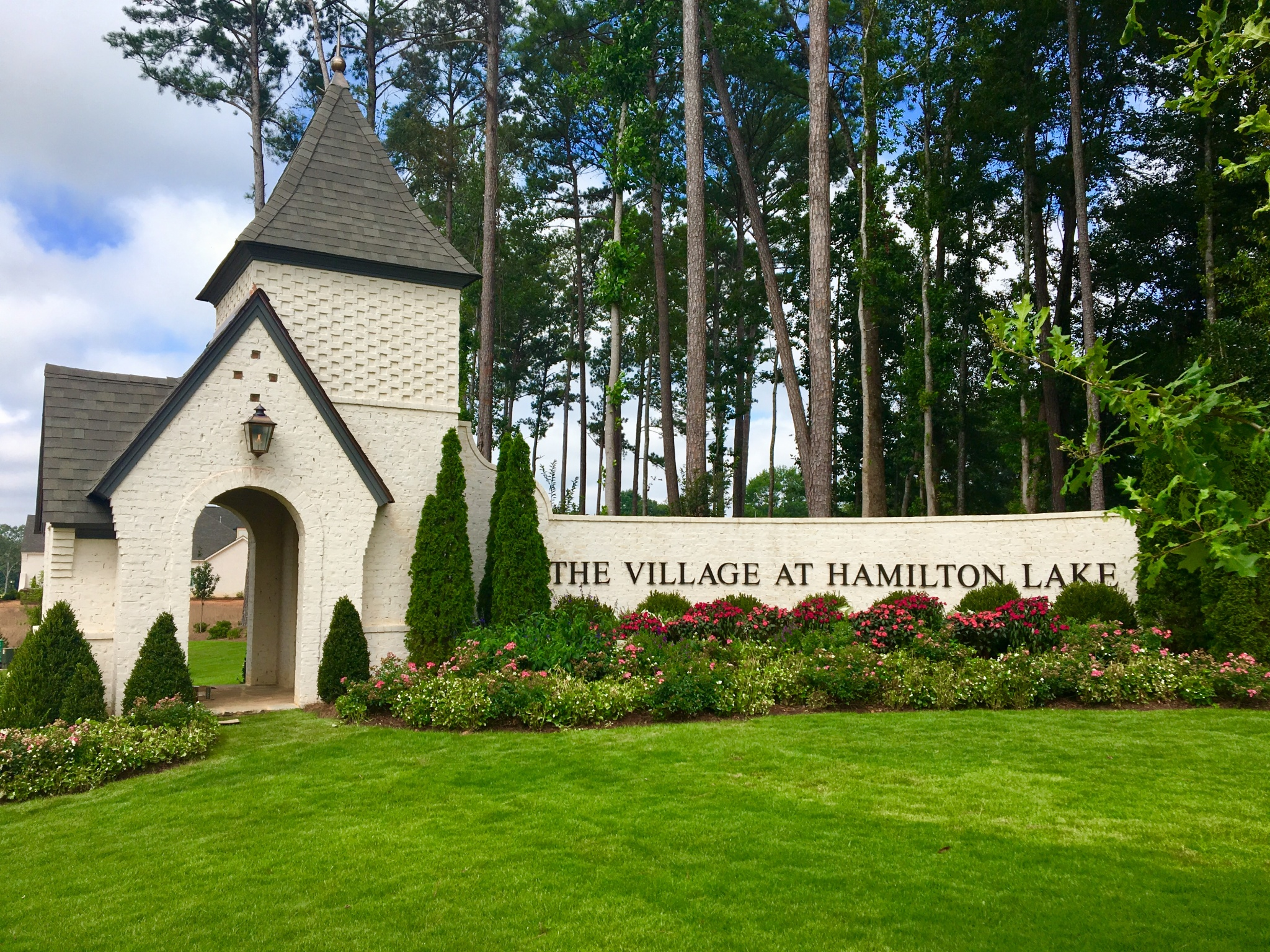 The Village at Hamilton Lake by Toland Construction - Logo